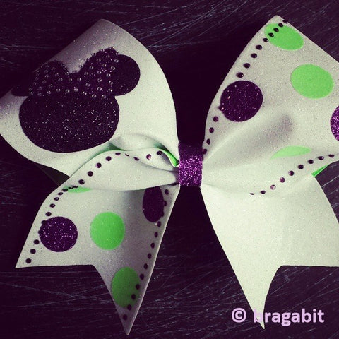 White glitter cheer bow with glitter designs and rhinestones. - BRAGABIT