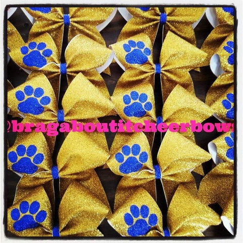Adelina Gold Glitter Cheer Bow with Royal Blue Paw