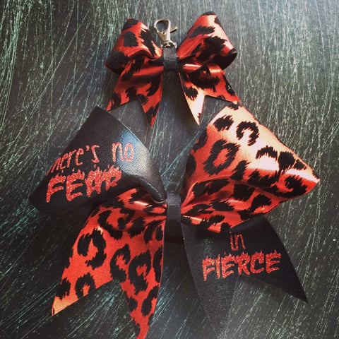 There's no fear in fierce cheer bow in black and red cheetah.