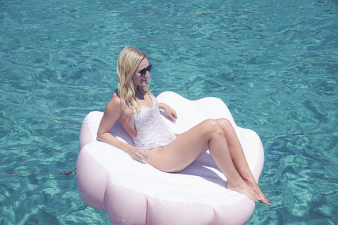 Kololo Pink Seashell floaty girl lounging in the ocean side view