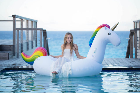 Kololo Giant Unicorn rainbow floaty girl sitting looking down
