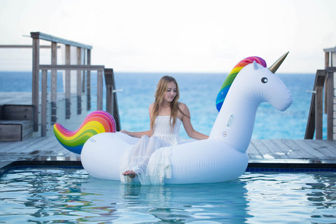 Kololo Giant Unicorn rainbow floaty girl sitting looking to the side