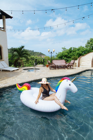 Kololo Giant Unicorn rainbow floaty girl lounging