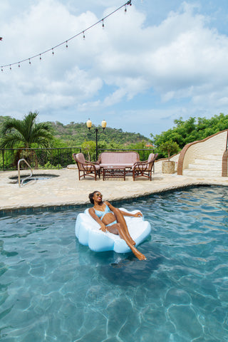 Kololo Blue Seashell floaty girl lounging at the pool
