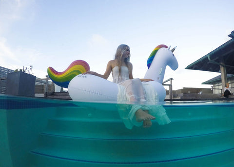 Kololo Giant Unicorn rainbow floaty girl sitting