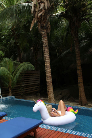 Kololo Big Unicorn rainbow floaty girl lounging