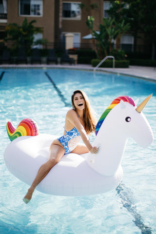 Kololo Giant Unicorn floaty girl smiling blue swimsuit pool