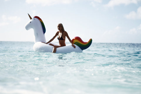 Kololo Giant Unicorn rainbow floaty girl at the ocean