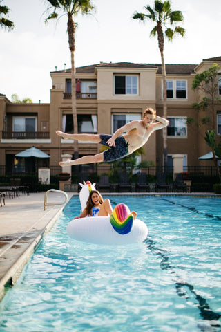 Kololo Giant Unicorn floaty girl with guy hovering above her