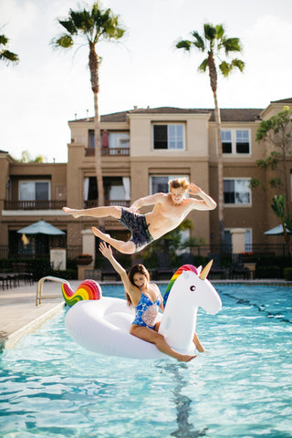 Kololo Giant Unicorn floaty girl sitting guy posing midair