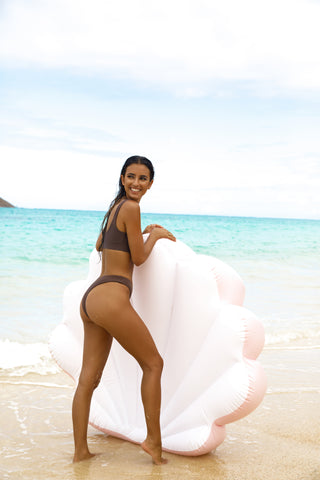 Kololo Pink Seashell floaty girl at the beach smiling