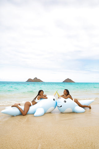 Kololo Giant Narwhal floaty 2 girls lounging at the beach