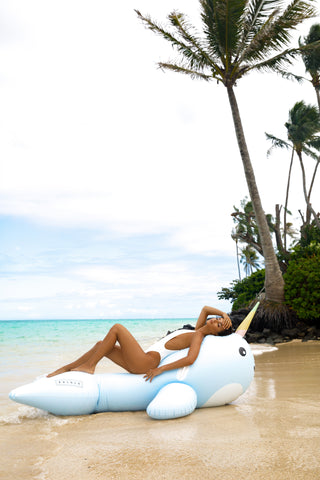 Kololo Giant Narwhal floaty girl at the beach relaxing