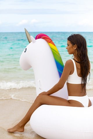 Kololo Giant Unicorn rainbow floaty girl sitting on unicorn close-up