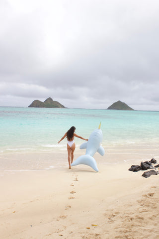 Kololo Giant Narwhal floaty girl walking on the beach