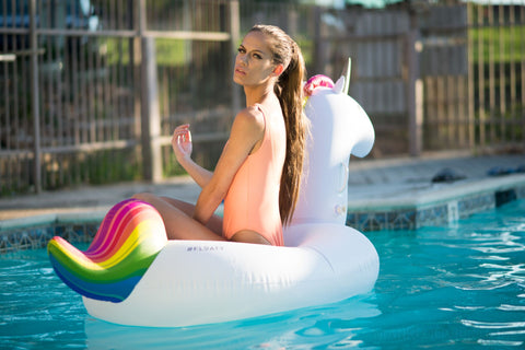 Kololo Big Unicorn rainbow floaty girl sitting posing