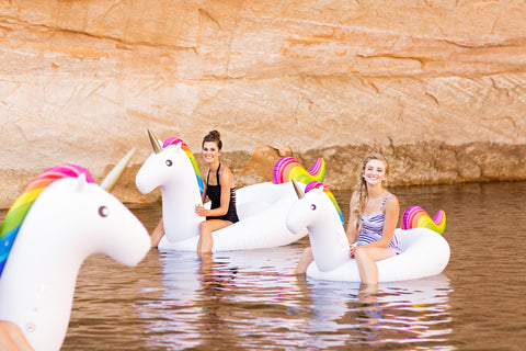 Kololo Giant Unicorn Big Unicorn rainbow floaty girls sitting having fun