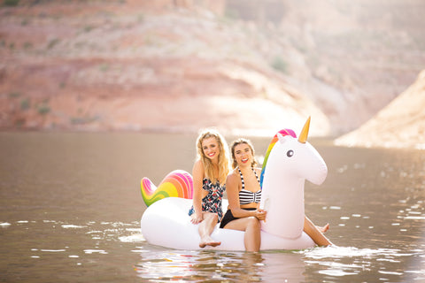 Kololo Giant Unicorn rainbow floaty girls at a lake smiling sunny