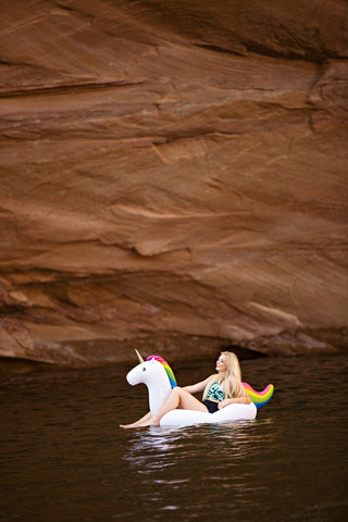 Kololo Big Unicorn rainbow floaty girl at the lake lounging