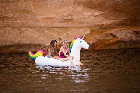 Kololo Giant Unicorn rainbow floaty girls at the lake relaxing sitting on the floaty