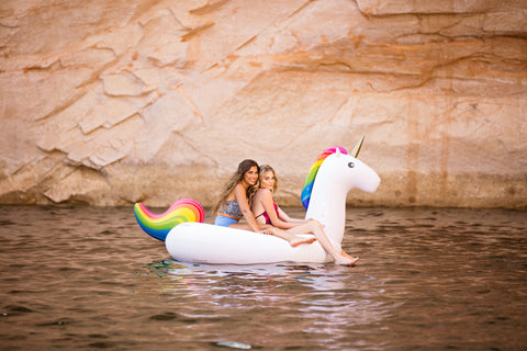 Kololo Giant Unicorn rainbow floaty girls at the lake sitting
