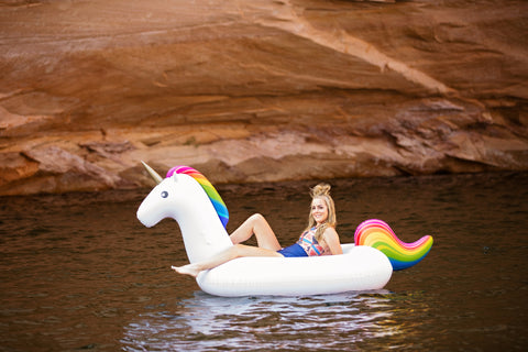 Kololo Giant Unicorn rainbow floaty one girl at the lake lounging