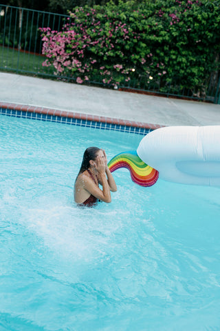 Kololo Giant Unicorn rainbow floaty girl in the pool