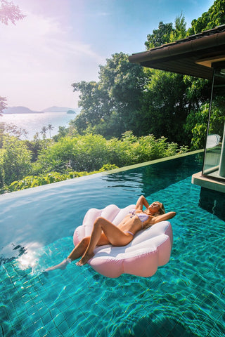 Kololo Pink Seashell floaty girl lounging at the infinity pool