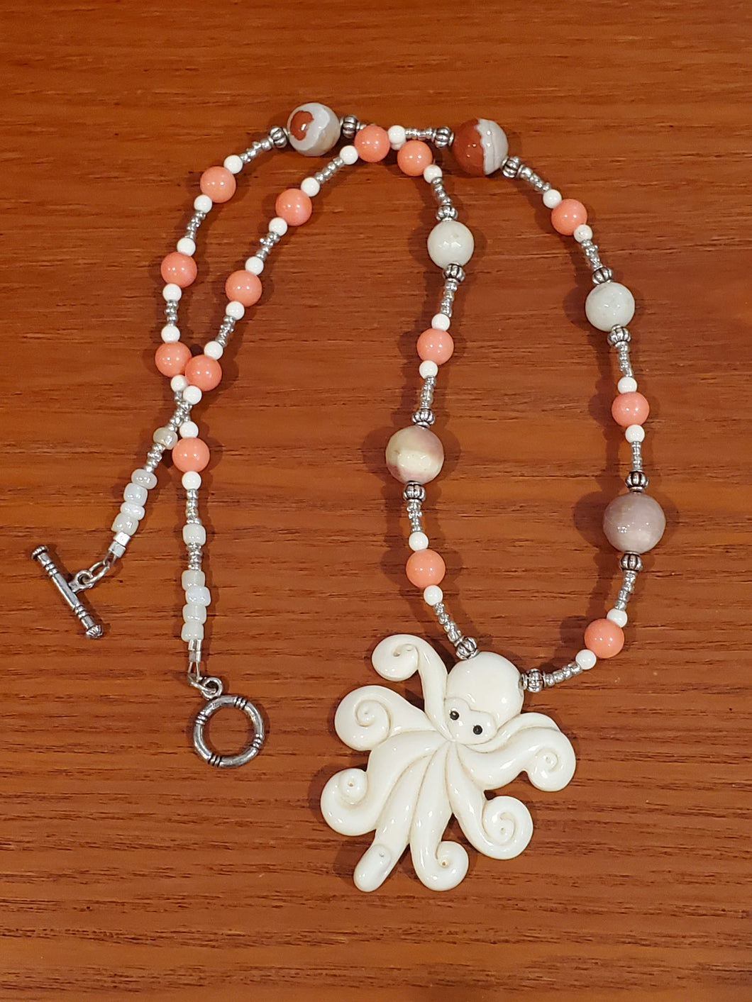 Bone Octopus with Coral Beads