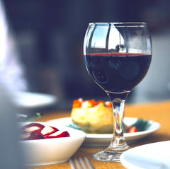 red wine glass with tapas