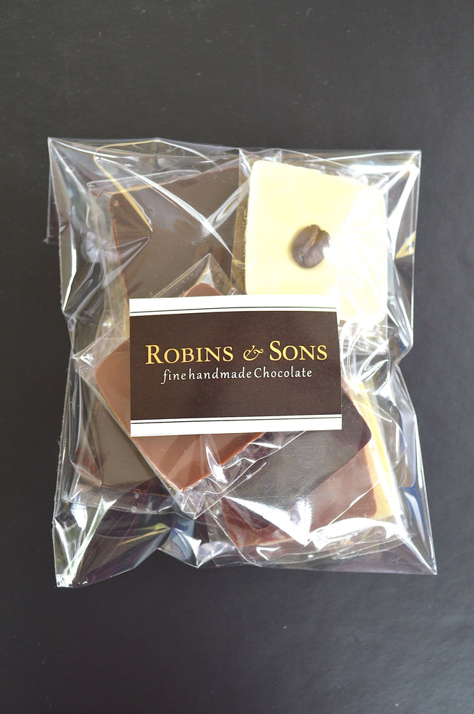 Luxury Belgian milk, white and dark chocolate squares with coffee beans