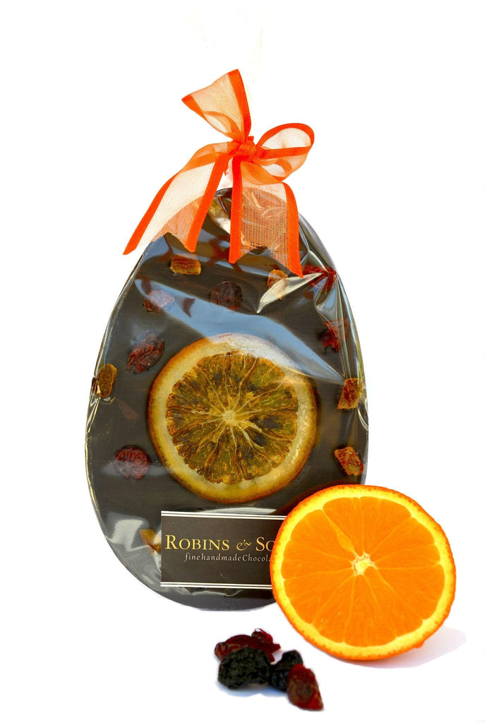 Luxury dark chocolate easter egg bar with whole orange slice and cranberries