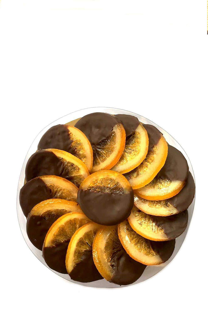 Whole candied orange slices coated in 70% dark Belgian chocolate