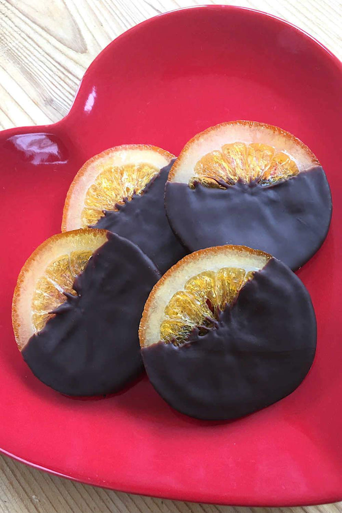 Whole orange slices covered / coated in Belgian dark chocolate