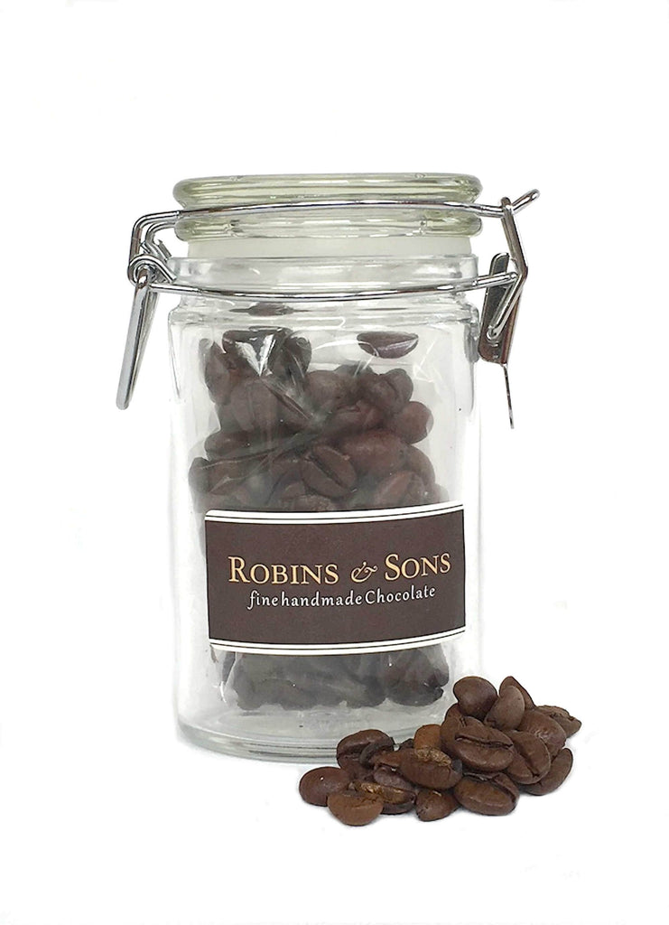 Gift bag with milk, white, dark chocolate, coffee beans, almond biscotti and sugar swizzle sticks