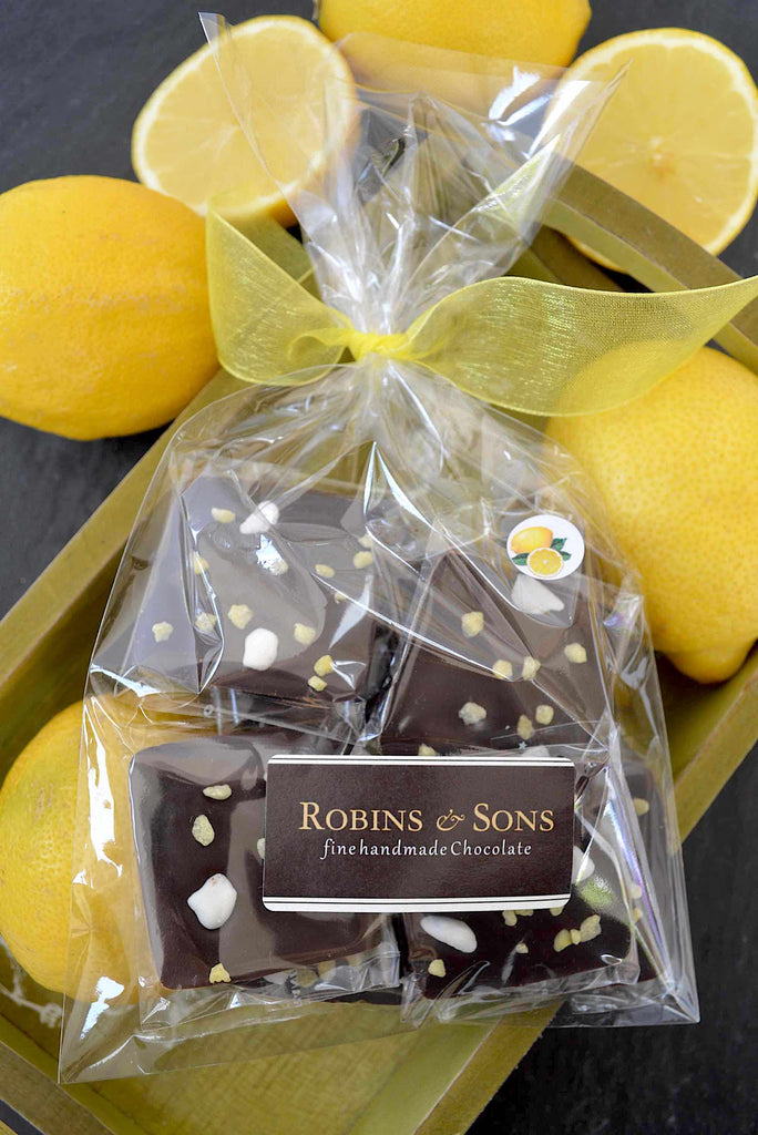 Belgian 70% dark chocolate squares with natural lemon oil and topped with lemon crystals and meringue