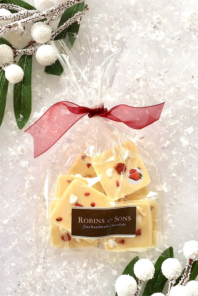 individually wrapped white chocolate squares topped with strawberries