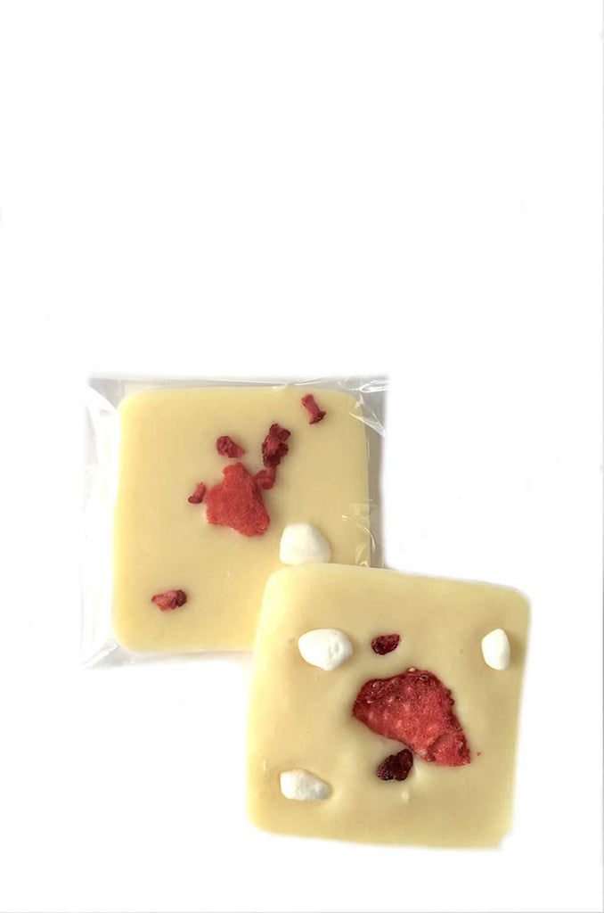 luxury individually wrapped white chocolate squares topped with strawberries