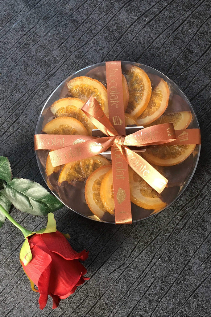 luxury box of dark chocolate covered candied orange peel slices