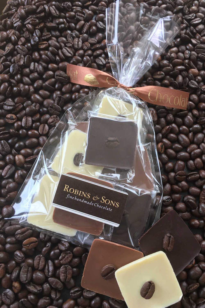 Individually wrapped Belgian milk white and dark chocolate squares topped with italian coffee beans