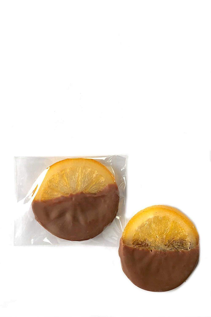 Individually wrapped luxury milk chocolate covered orange slices peel