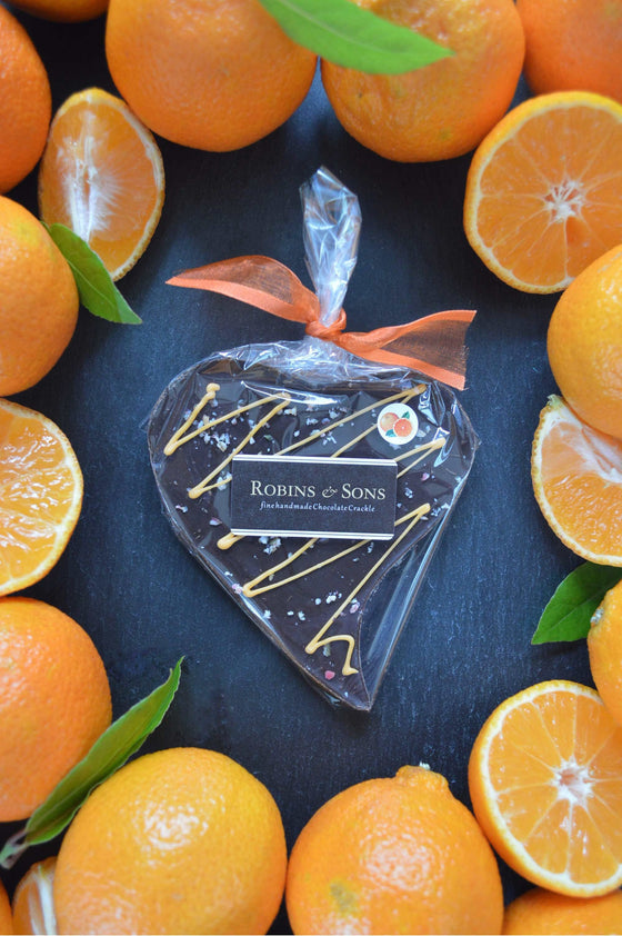 Heart shape bar of 70% dark Belgian chocolate with natural orange oil and fruit candy cane nibs