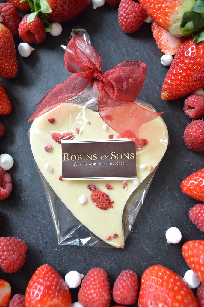luxury white chocolate heart bar with strawberries raspberries meringue