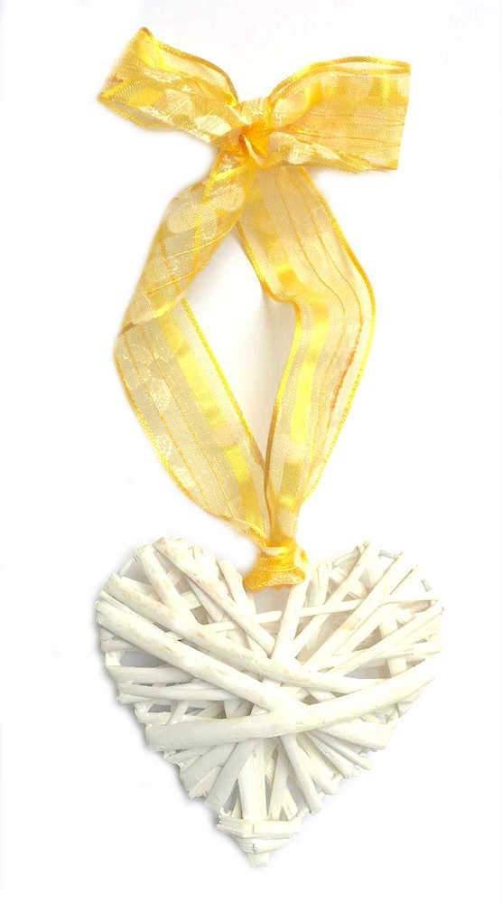 White wicker heart hanging decoration with yellow ribbon