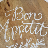 """Bon Appetit"" Calligraphy Quote Round Cutting Board With Leather Strap"
