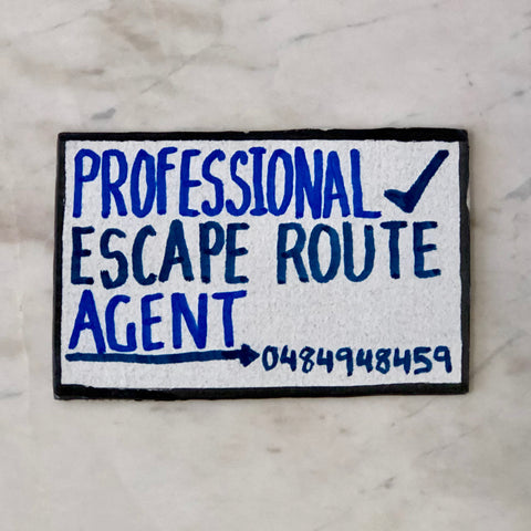 Lucas Grogan 'Professional Escape Route Agent' business card