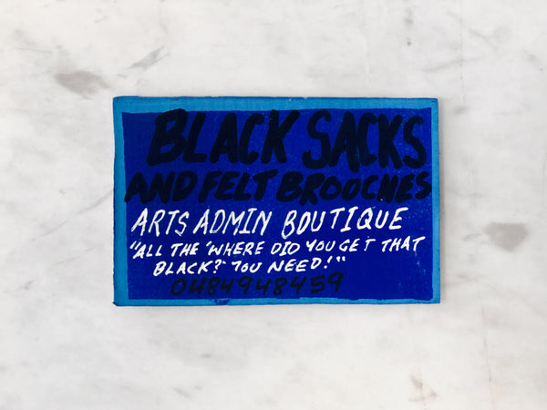 Lucas Grogan 'Black Sacks & Felt Brooches' business card