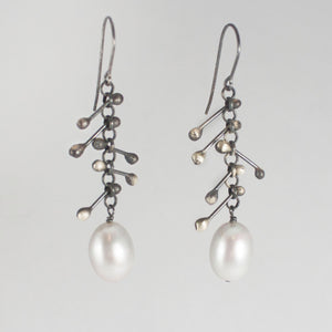 Grey pearl spiked earrings