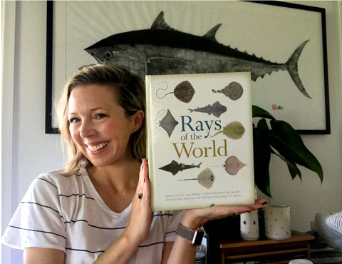 Dr Lindsay Marshall and her copy of Rays of the World
