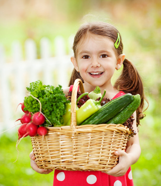 young-girl-with-basket-of-vegetables